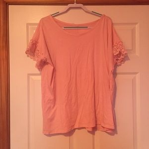 Pink top with lacy sleeves